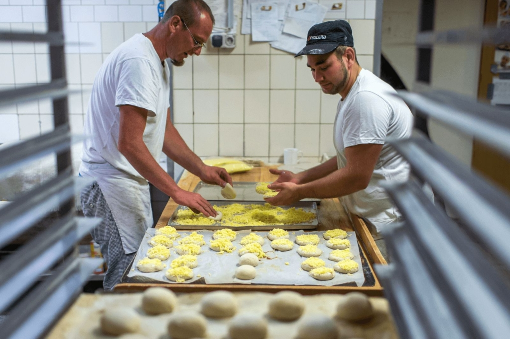 Two men working in a bakery