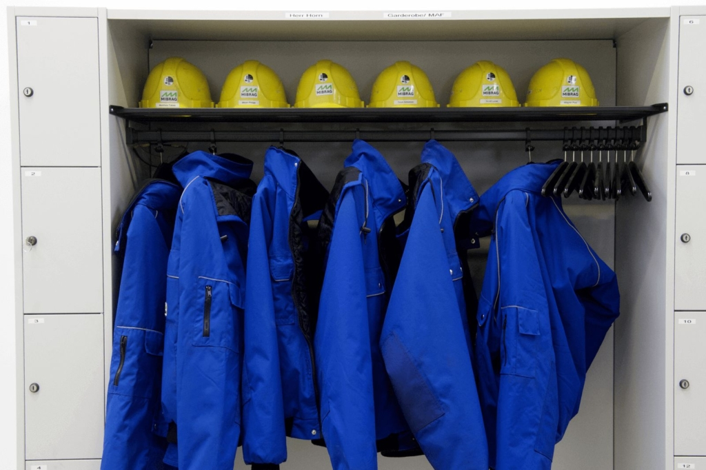 A cupboard containing protective work clothing