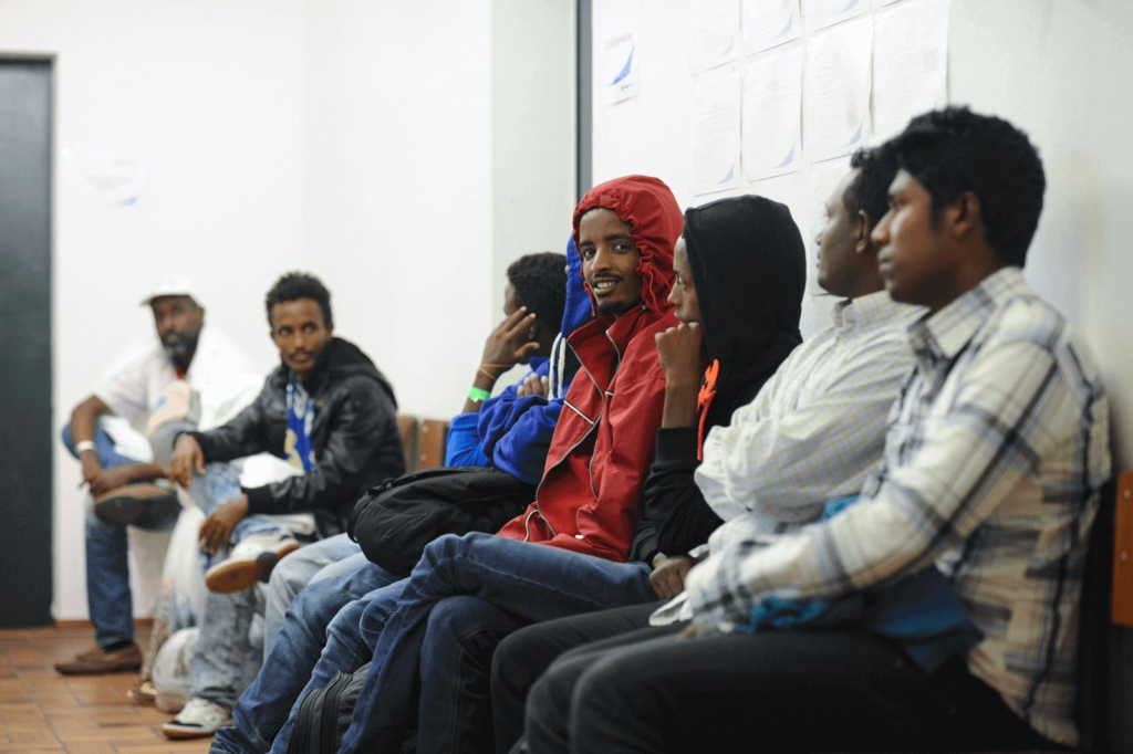 Asylum-seekers in a waiting area