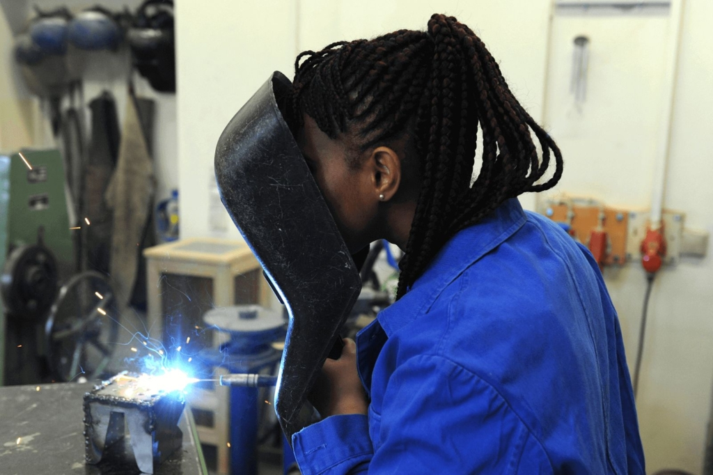 A woman at a welding machine