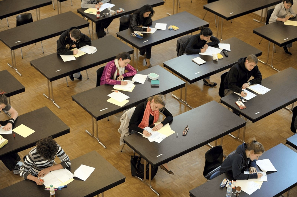 Students taking a written exam