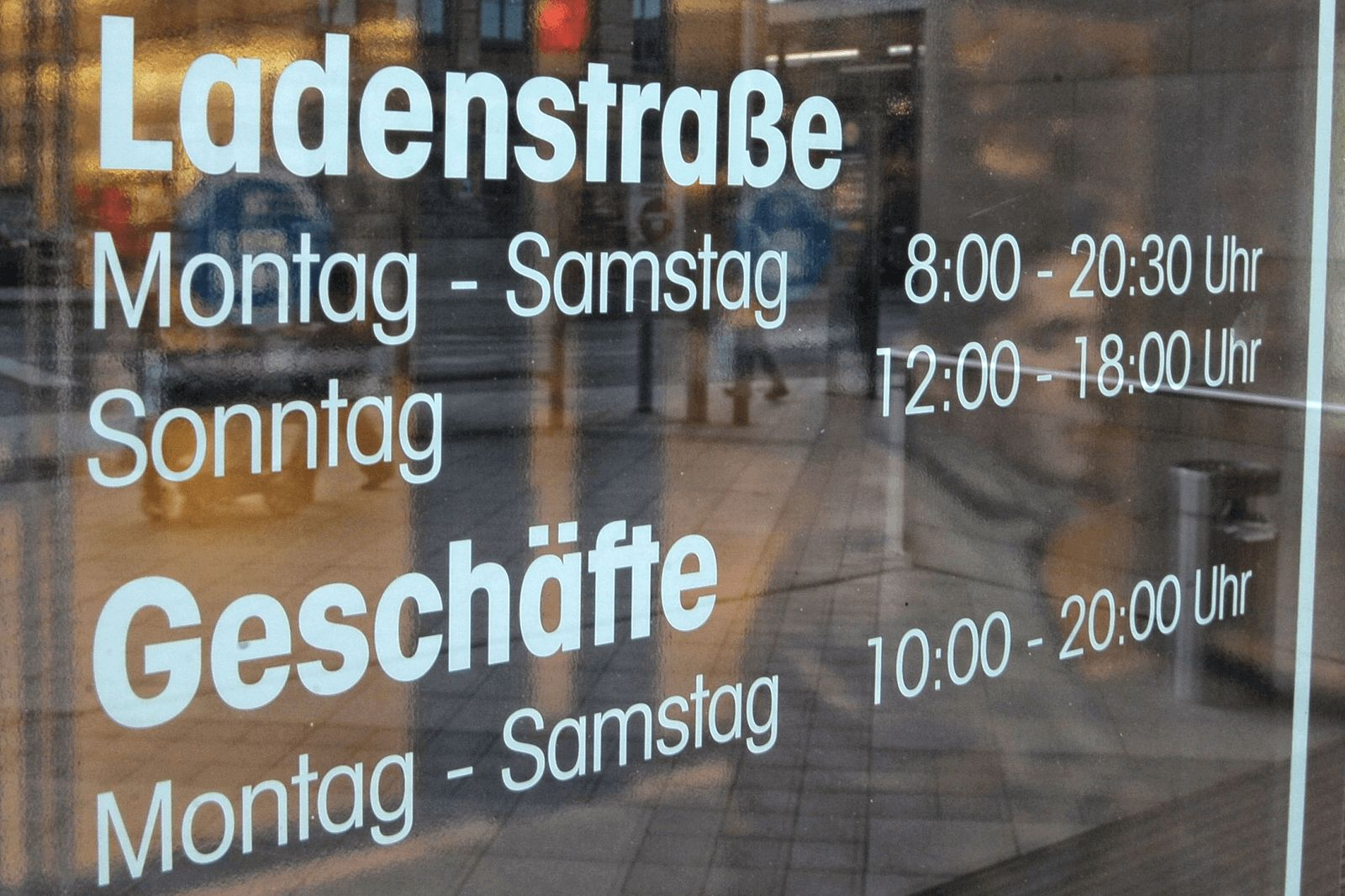 Shop window showing opening hours